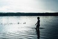 Boy in a lake at dusk - MJF02306
