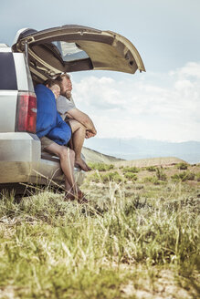 Mature man and teenage son looking out from off road vehicle, Bridger, Montana, USA - CUF17418