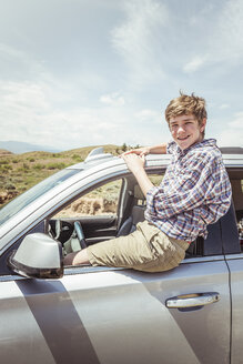 Portrait of teenage boy sitting on off road vehicle window, Bridger, Montana, USA - CUF17424