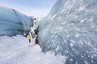 Woman exploring glacier, Solheimajokull, Iceland - CUF17442