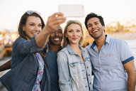 Adult friends taking smartphone selfie on pier, Santa Monica, California, USA - ISF06653