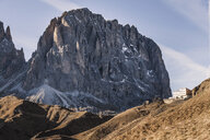 Rugged mountain landscape and hillside building, Dolomites, Italy - CUF17861
