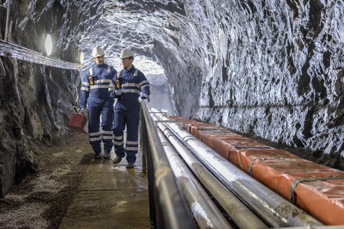 Workers in tunnel in hydroelectric power station - CUF17963
