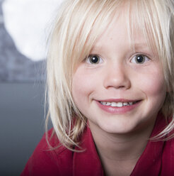 Close up portrait of blonde haired boy looking at camera smiling - ISF06724