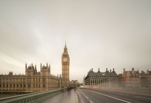 Blurred traffic crossing Westminster Bridge to Palace of Westminster, London, UK - CUF18025