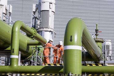 Worker with coolant pipes at gas-fired power station - CUF18084