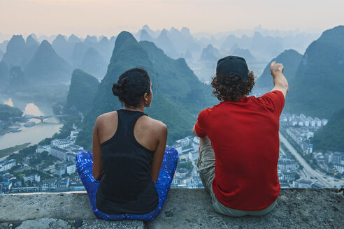 Couple enjoying morning view over Karst Mountains of Guangxi and Yangshuo, China - CUF18284