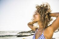Happy woman on beach - CUF18302