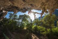 Mature woman rock climbing, close to Thakhek, Khammouane, Laos - CUF18642