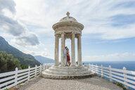 Romantic mid adult couple at coastal monument, Majorca, Spain - CUF18765