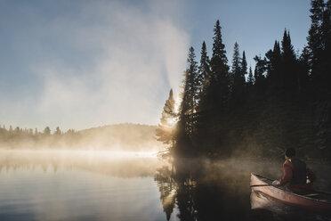 Senior man canoeing on lake - CUF19187