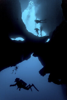 Diver swimming in cave system, Moalboal, Cebu, Philippines - CUF19277