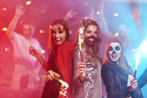 Friends in creepy costumes having fun at Halloween party - ABIF00510