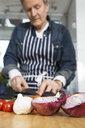 Man preparing food in kitchen - CUF20003