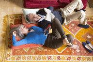 Couple reading book on floor - CUF20069