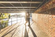 Romantic young couple under bridge on Regent's Canal, London, UK - CUF20158