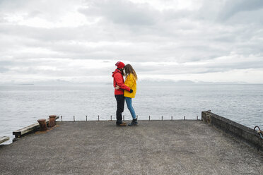 Iceland, North of Iceland, young couple standing on jetty - AFVF00601