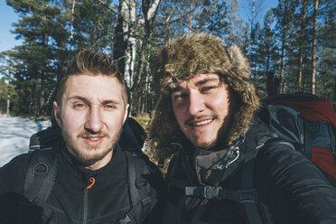 Sweden, Sodermanland, portrait of two smiling men in remote landscape in winter - GUSF00916