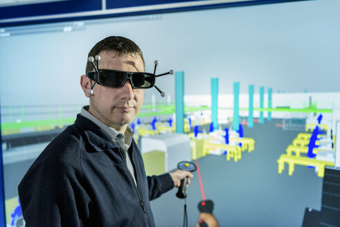 Portrait of engineer with factory graphic in 3D in virtual reality suite - CUF20402