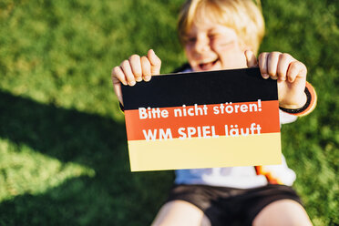 Boy showing do not disturb sign due to socce world championship - MJF02319