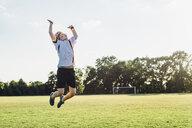 Boy wearing German football shirt playing soccer - MJF02331