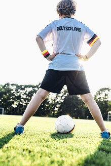 Boy wearing football shirt with Germany written on back - MJF02337