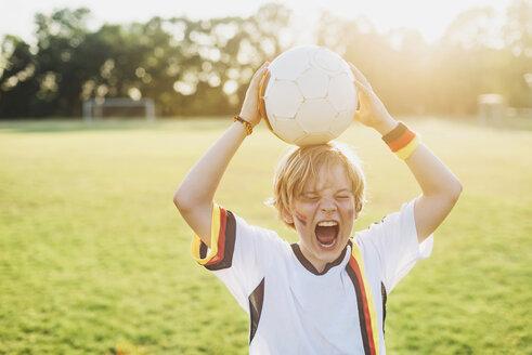 Boy wearing German soccer shirt screaming for joy - MJF02343