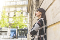 Young woman leaning against wall gazing Paris, France - CUF20515