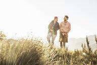 Couple walking in field - CUF20779
