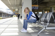 Young woman waiting on bench of a platform in Berlin - BFRF01824