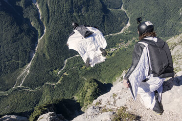 Wingsuit BASE jumper is flying down, filmed by another BASE jumper, Italian Alps, Alleghe, Belluno, Italy - CUF21020