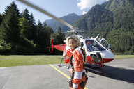 First time female tandem sky diver getting ready for helicopter, Interlaken, Berne, Switzerland - CUF21026