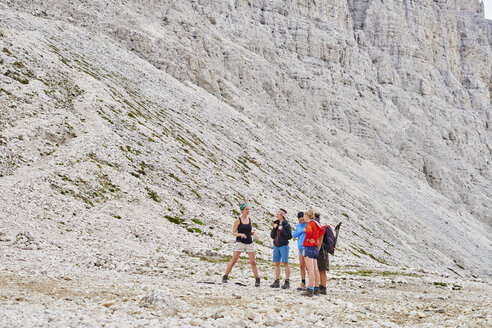 Hikers at bottom of rocky mountain, Austria - CUF21062