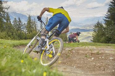 Austria, Tyrol, Downhill mountain biker - CVF00639