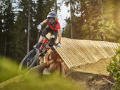 Austria, Tyrol, female downhill mountain biker - CVF00642