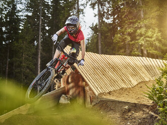 Austria, Tyrol, female downhill mountain biker - CVF00642
