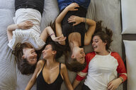 Four friends relaxing on couch at home - AFVF00613