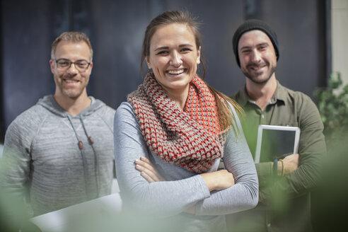 Portrait of happy colleagues in office - ZEF15552