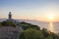 Greece, Gulf of Corinth, Perachora, Lighthouse at Heraion at sunset - MAMF00110