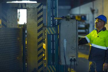 Engineer in industrial plant inspecting machines - ZEF15587
