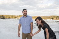 Couple laughing on snow-covered landscape, Ottawa, Ontario - ISF07741