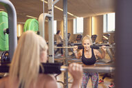 Woman working out in gym - CUF21404