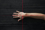 Human hand getting scanned by red light rays - PDF01664