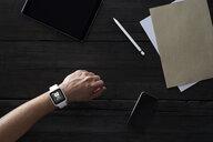 Man wearing smartwatch in office - PDF01688