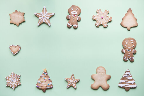 Various gingerbread decorated with sugar icing on bright green ground - SKCF00462