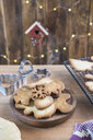 Various home-baked gingerbread cookies on wooden plate - SKCF00477