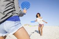 Women on beach playing tennis - CUF21468