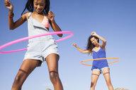 Women using hula hoop - CUF21474