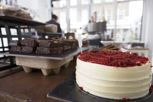 Red velvet cake and chocolate brownies on cafe counter - CUF21617
