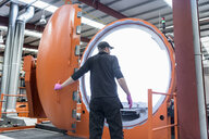Engineer with autoclave in racing car factory - CUF21680